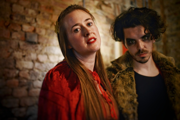 Stephanie Hazel stars as Red and Andrew Bate stars as Wolf in Moth Sanctuary Productions performance of In The Company of Wolves at Cheltenham Literature Festival 2019.